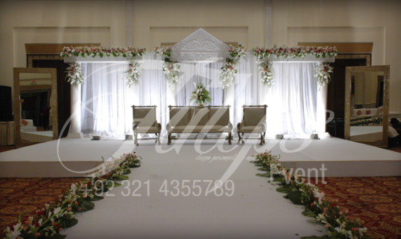 Green walima tulips event management for 25th wedding anniversary stage decoration