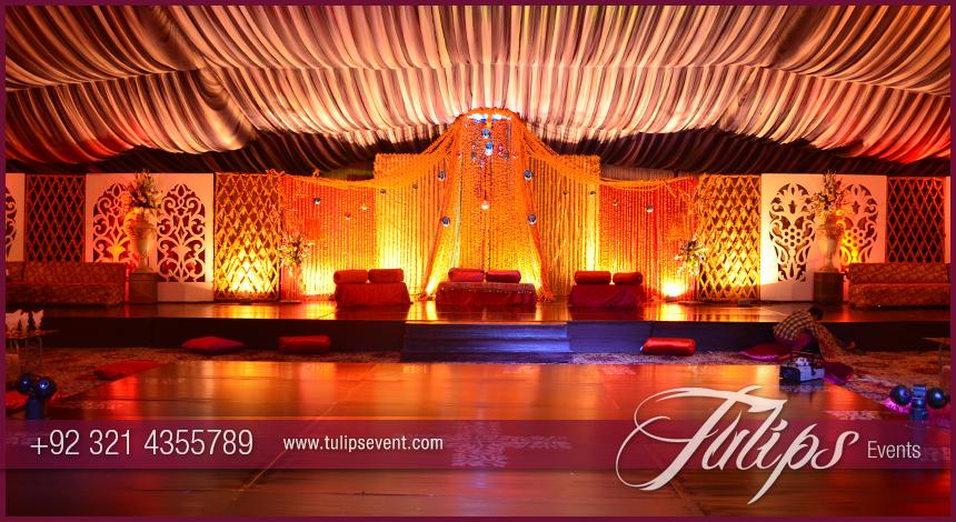 Outdoor open wedding event stage setup in pakistan merigold mehndi stage decoration junglespirit Gallery