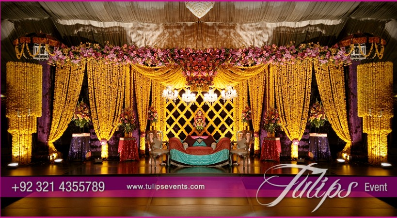 Mehndi Flower Arrangements : Yellow drape mehndi stage tulips event management