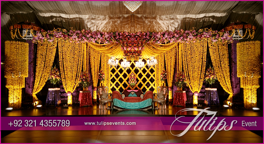 Yellow drape mehndi stage tulips event management for Mehndi decoration